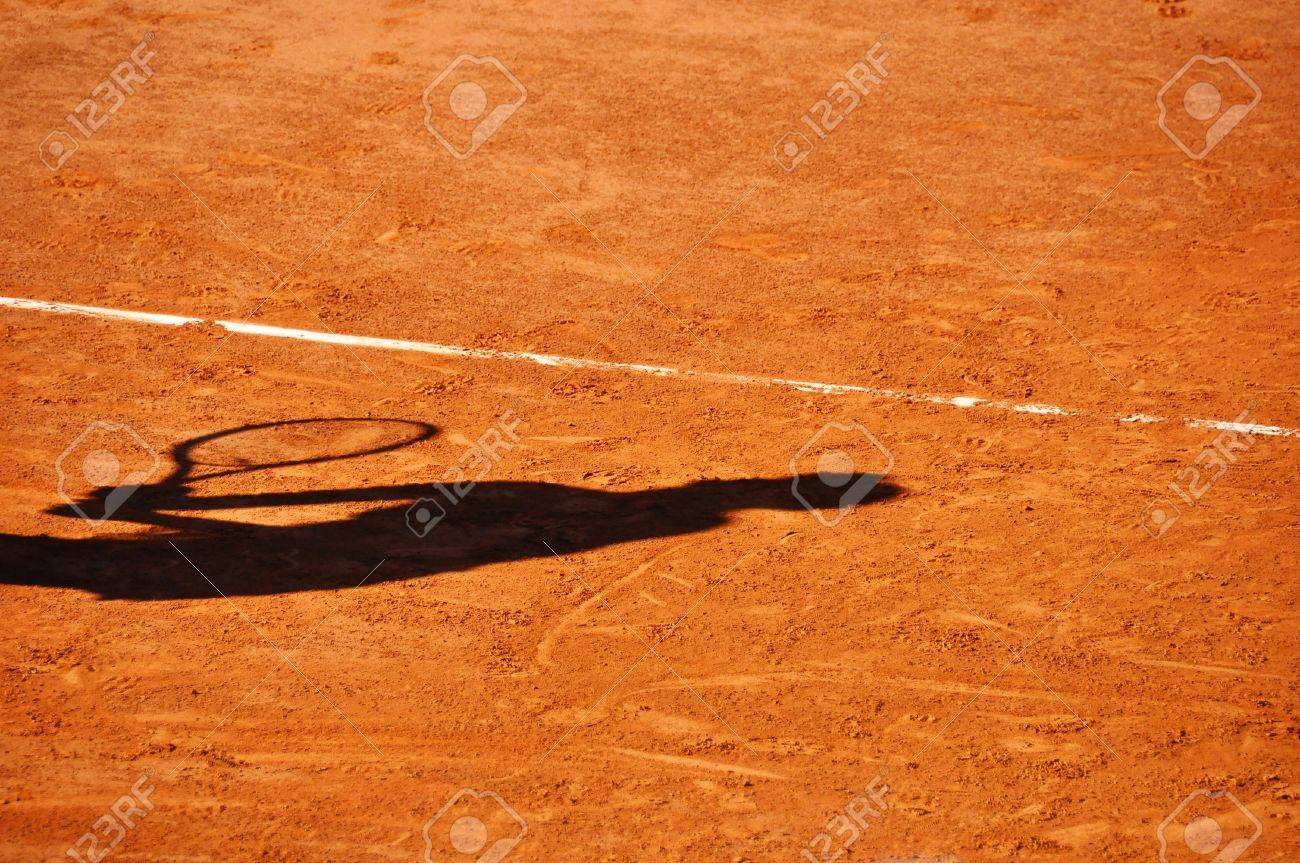 Tennis player shadow on a clay tennis court Stock Photo - 17443500