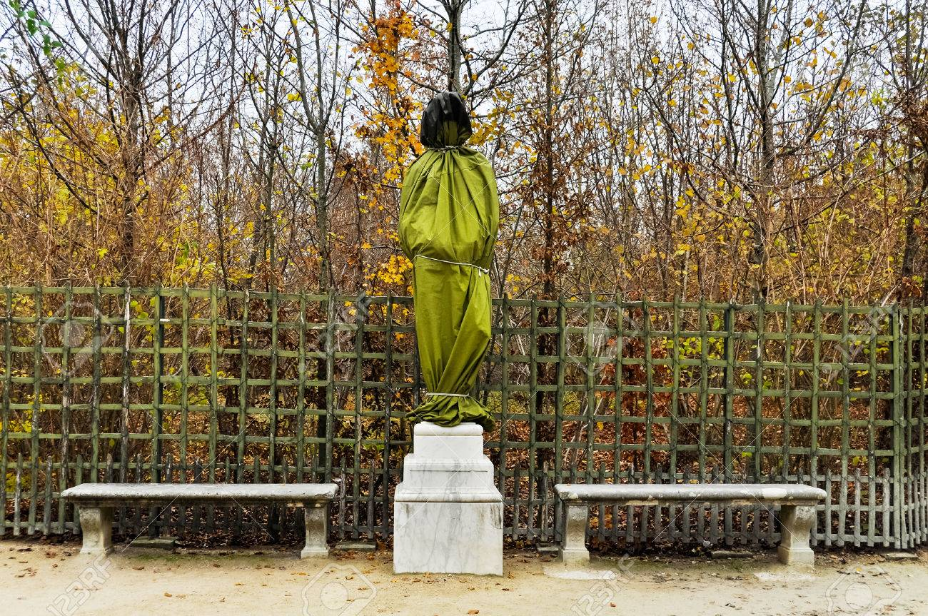 wrapped statue in the versailles gardens in winter stock photo