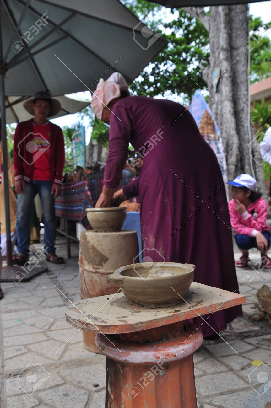 Nha Trang, Vietnam - July 11, 2015: An old woman is performing