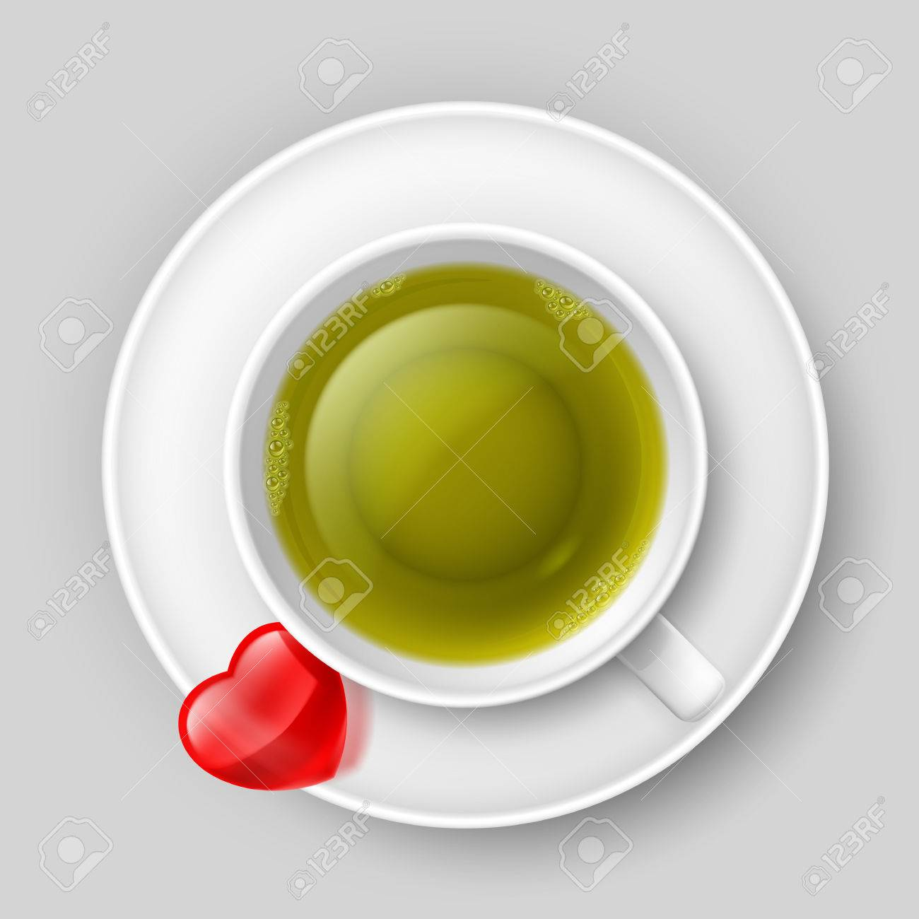 Cup Of Green Tea With Red Heart On Saucer Top View Royalty Free