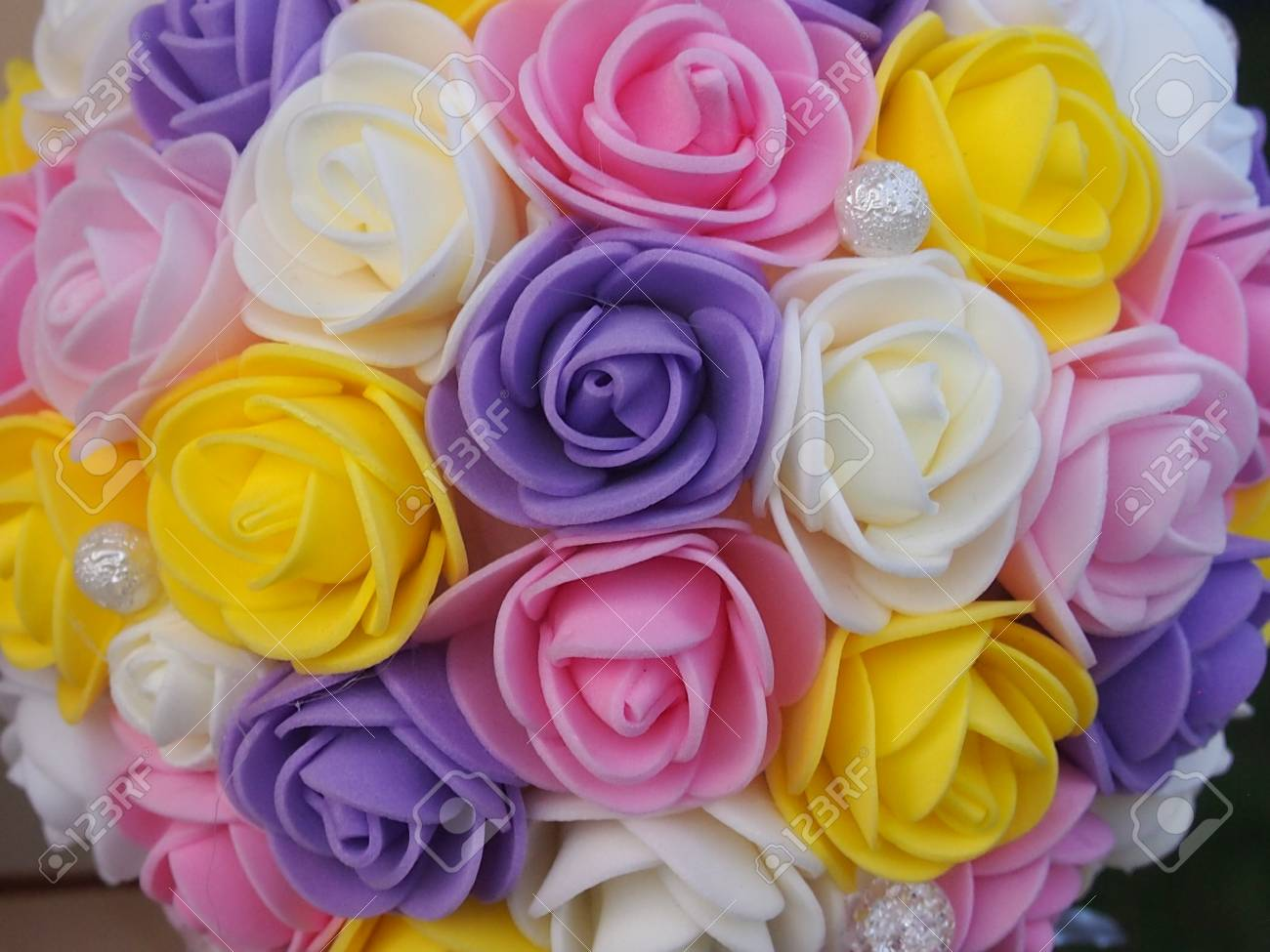 The Bouquets Of Artificial Flowers Made From Various Materials Stock
