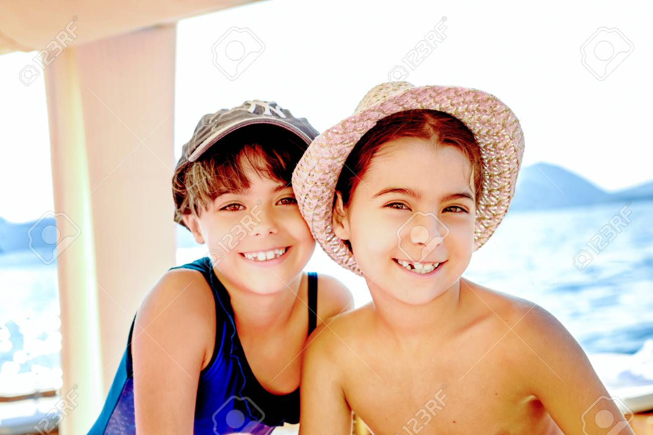 Adorable little girls twins with the summer hats in a faded look Stock  Photo - 43642796 eec4f3f9f0b