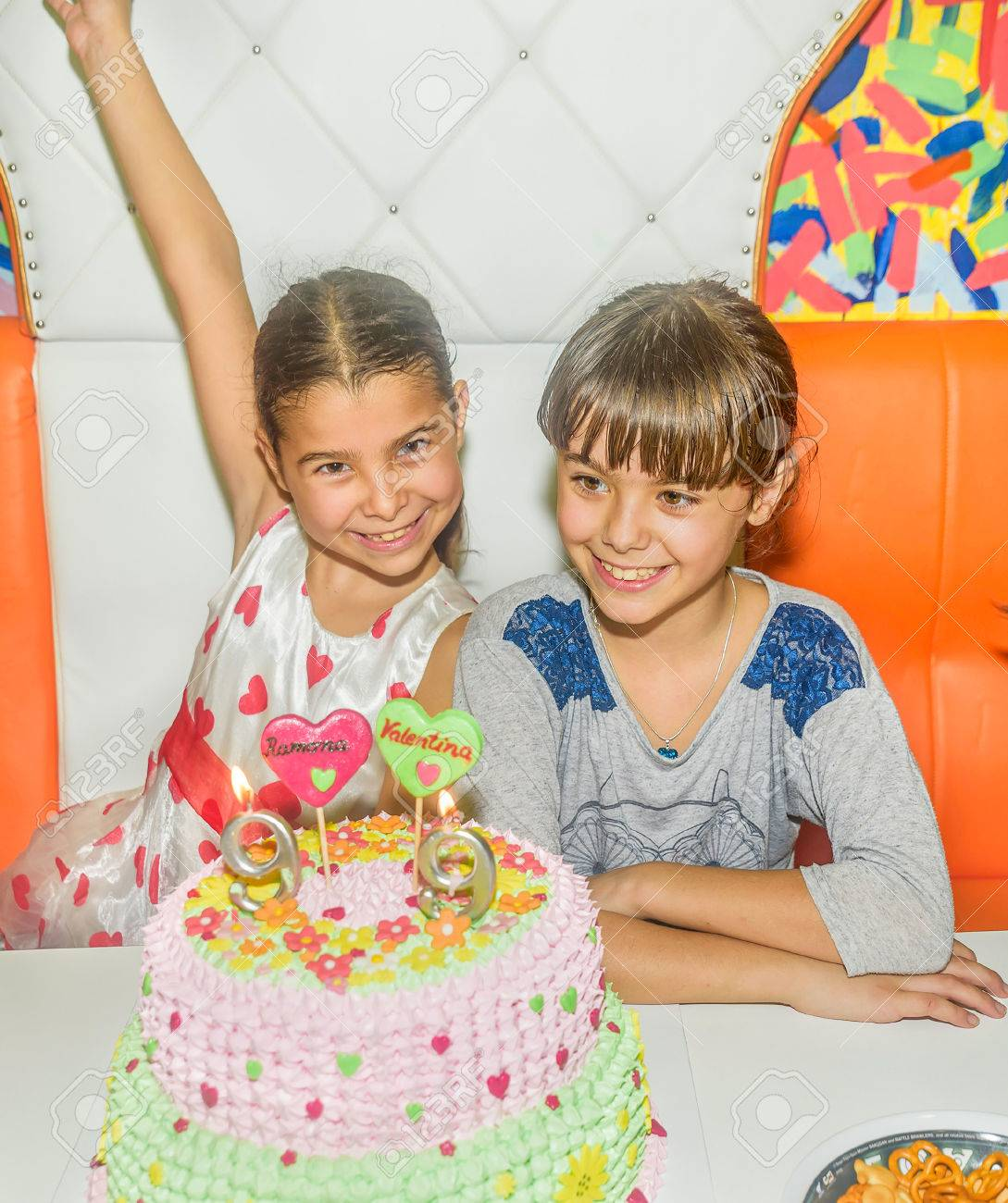 Twin Sisters At Birthday Celebration With Cake Stock Photo Picture