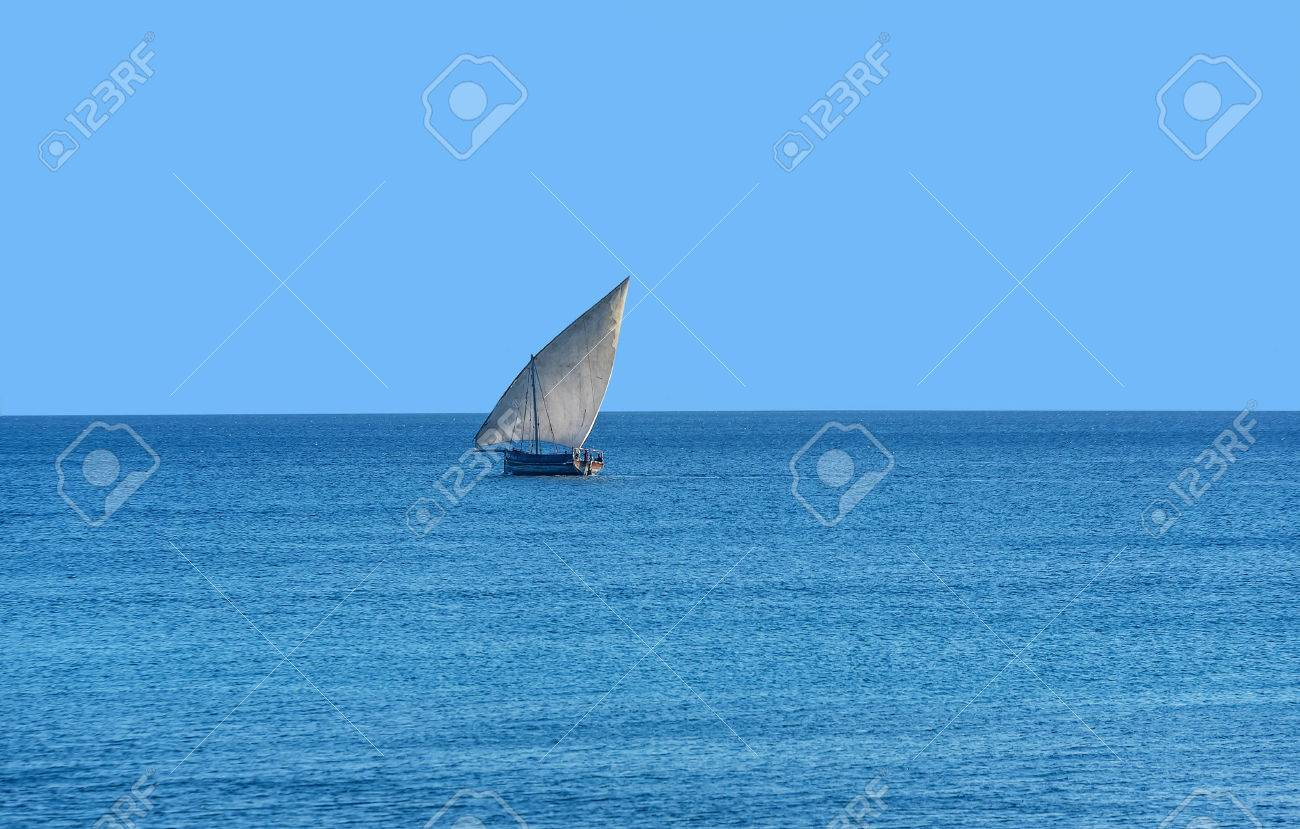 Traditional Tanzanian dhow boats on open sea close to Stone Town