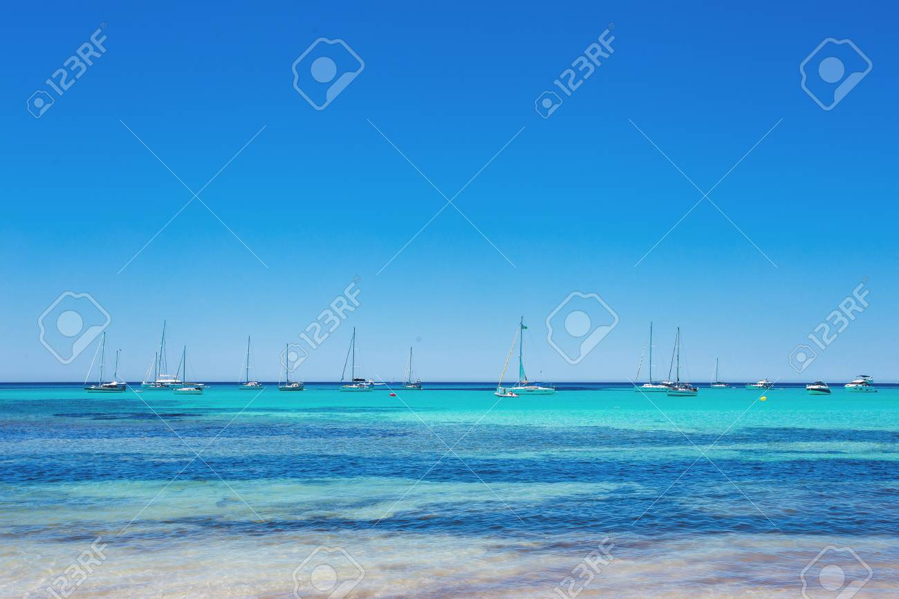 Es Trenc - amazing beach with beautiful clear water and lots of yachts, Mallorca Island, Spain - 97564506