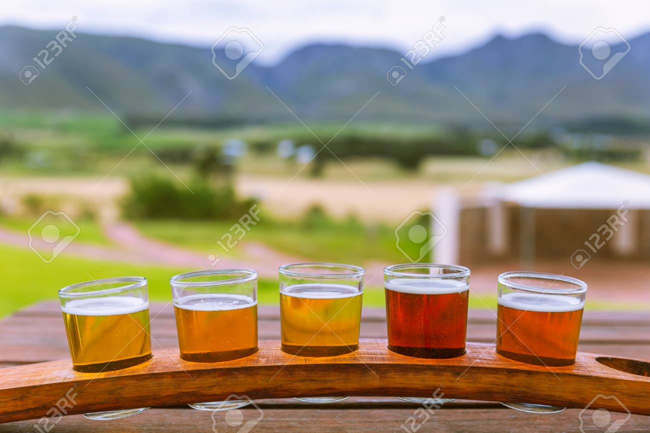 Beer Tasting Glasses On A Wooden Tray Outside The Brewery With