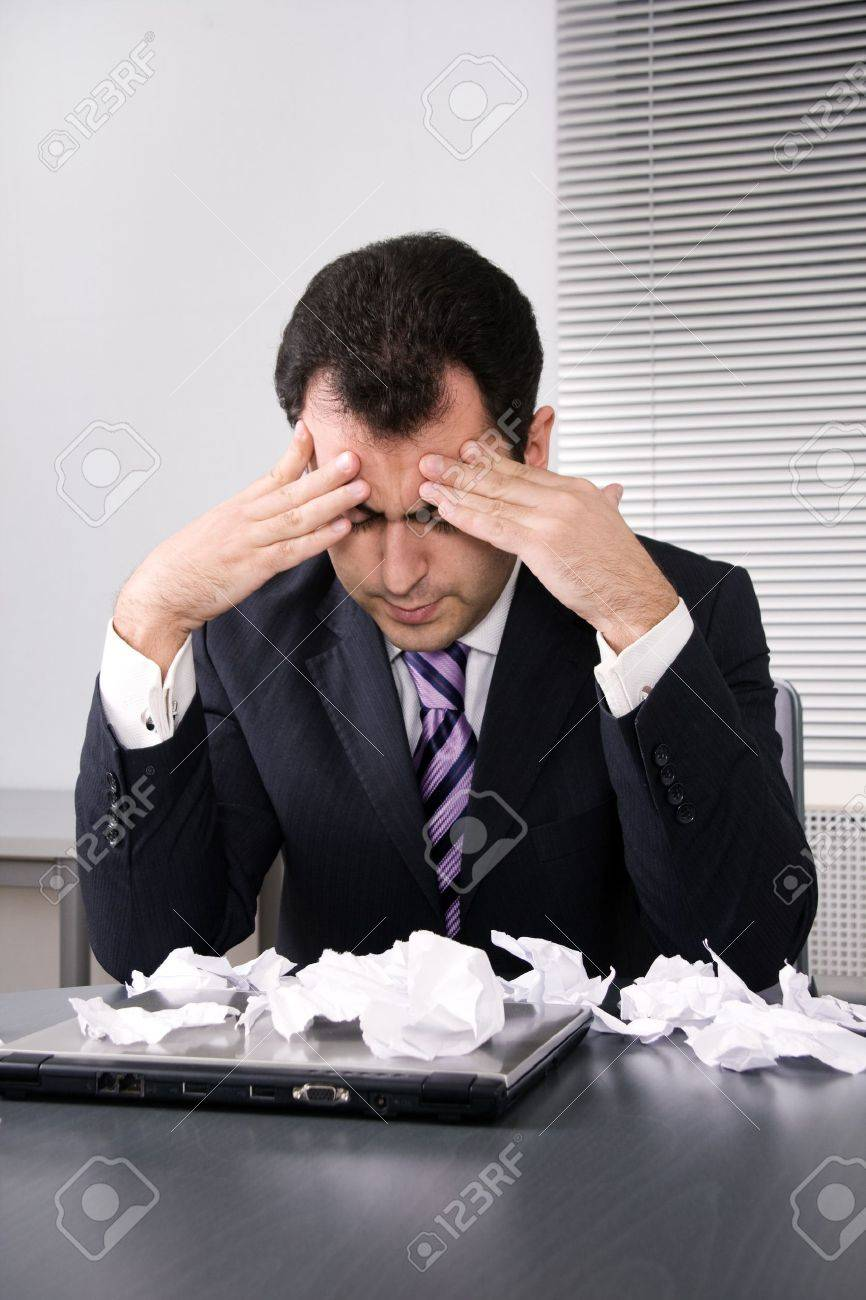 Frustrated businessman looking on disaster. Stock Photo - 3978399