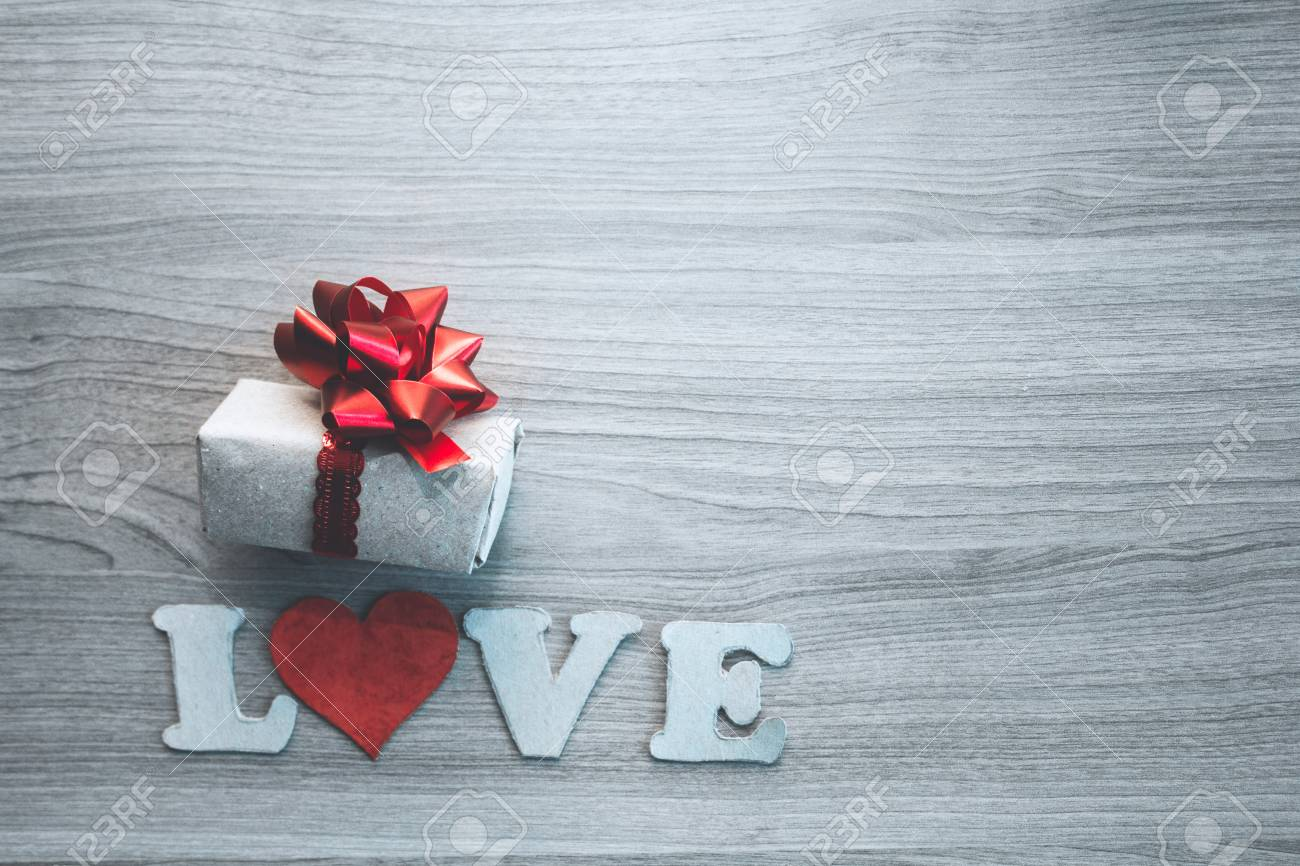 Love letters cardboard heart and gift box with red bow. concept