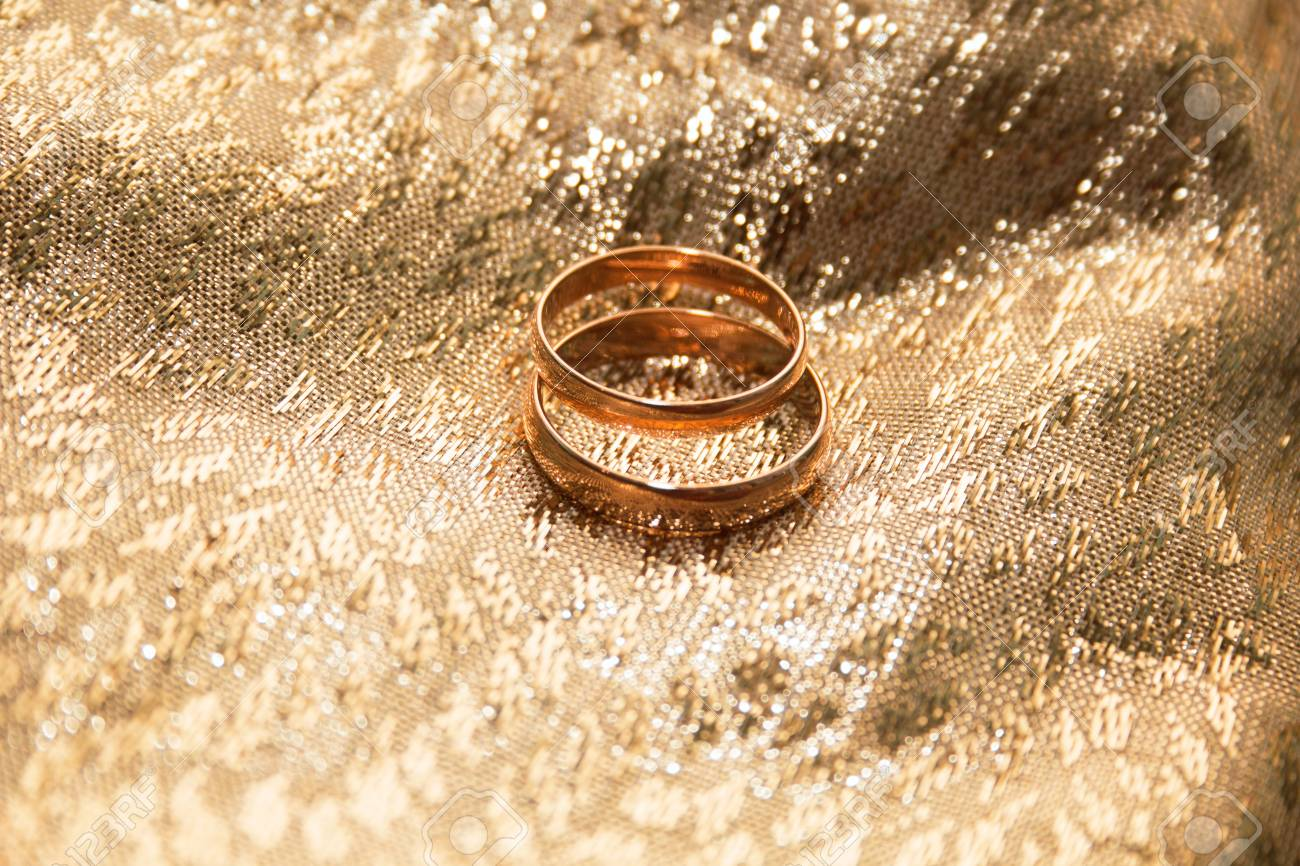 Gold Wedding Rings On A Gold Cloth Background Stock Photo Picture