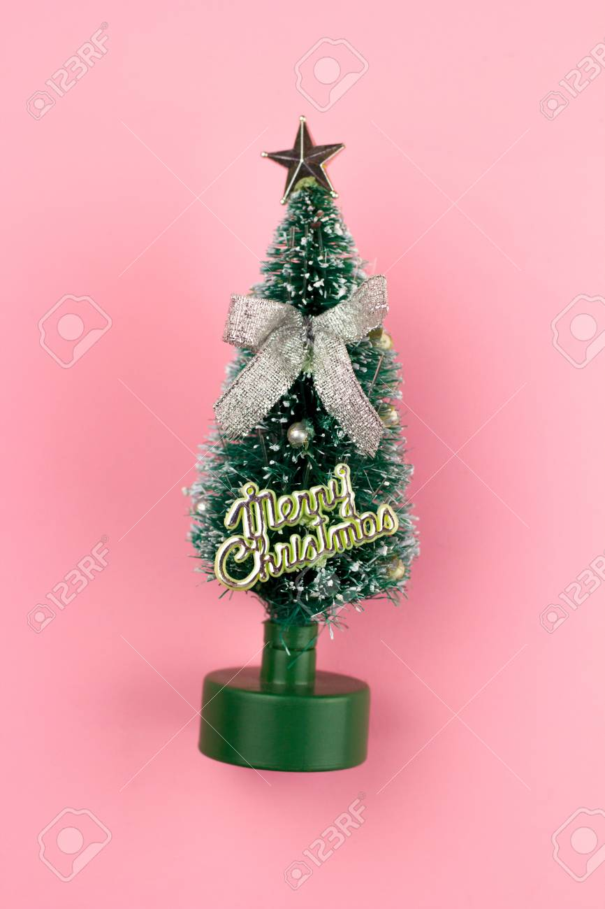 Christmas Tree Top View.Small Toy Decorative Christmas Tree Top View On Pink Pastel Background
