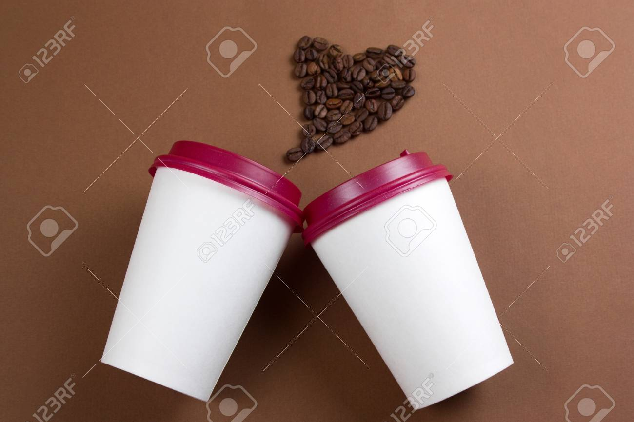 Top View White Paper Coffee To Go Cups And Heart Made From Coffee
