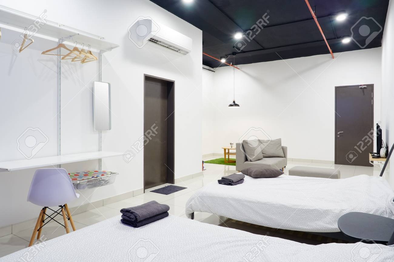 A studio apartment with bed and living section. Clean and modern..