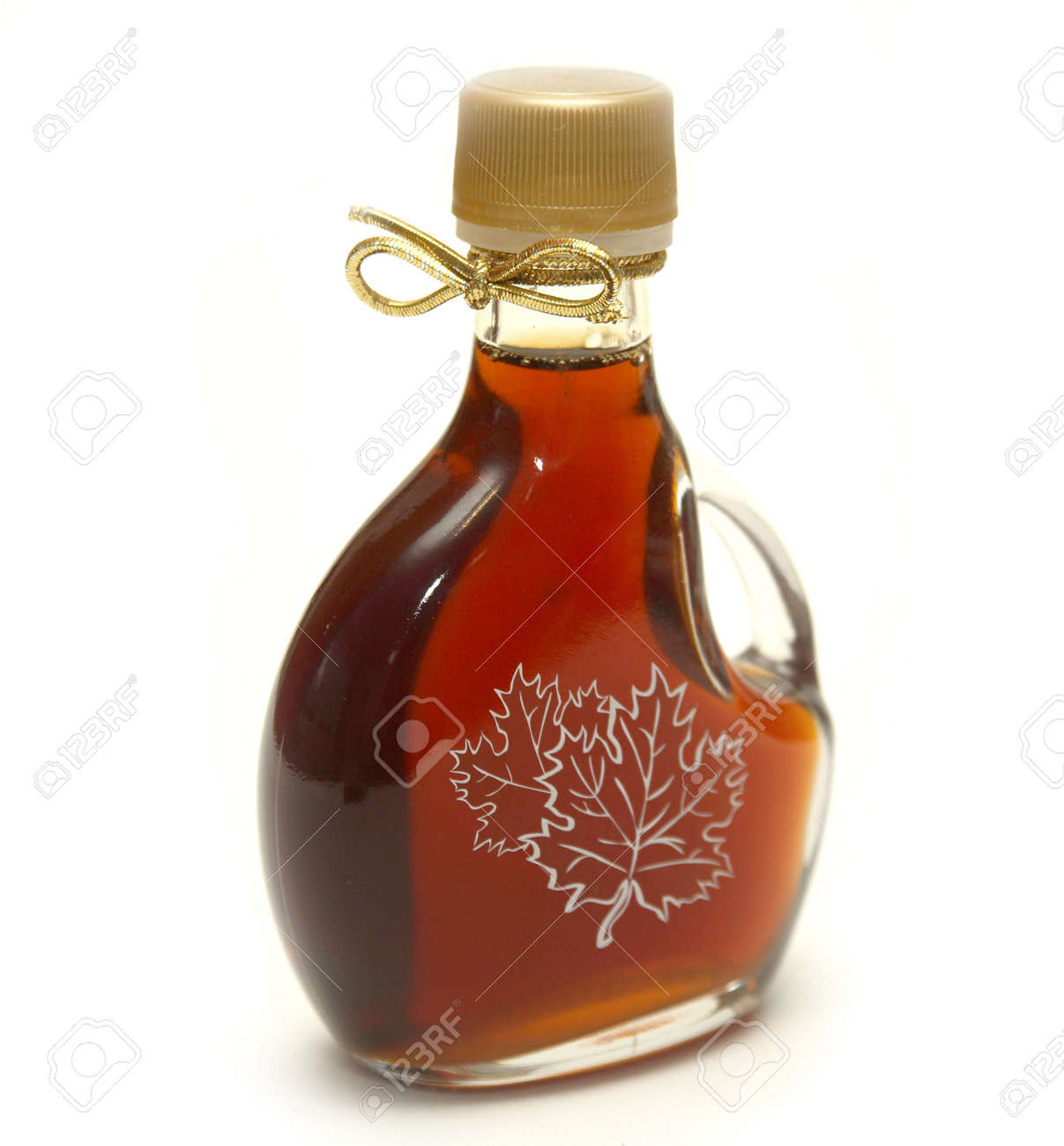 A small bottle of maple syrup with the maple leaves printed on the front and a nice golden ribbon on the neck! Stock Photo - 1842541