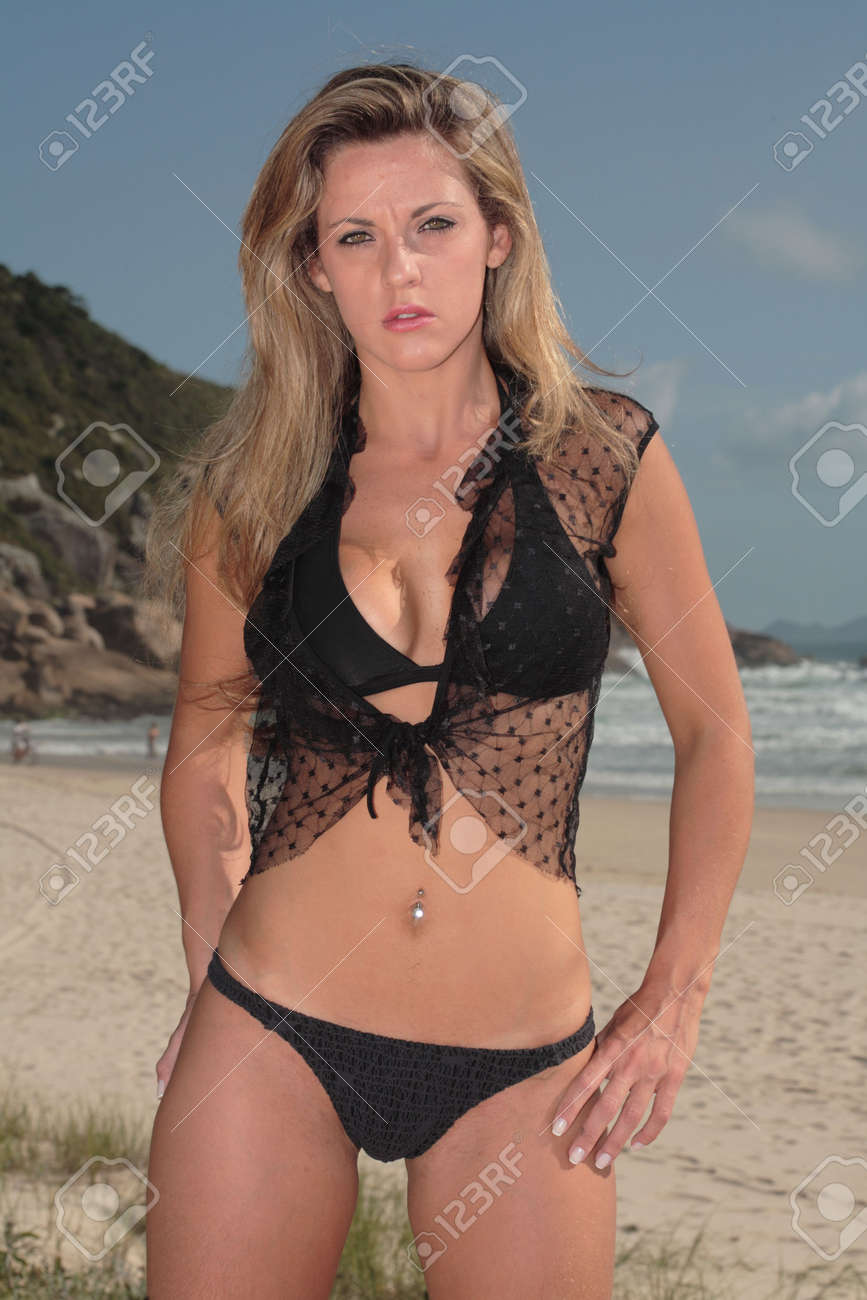 A blonde, 20-30 year old female model on the beach, in Florian�polis - Brazil. This is part of a series. Have a look at the other photos of this model in various outfits and poses. Stock Photo - 2050754
