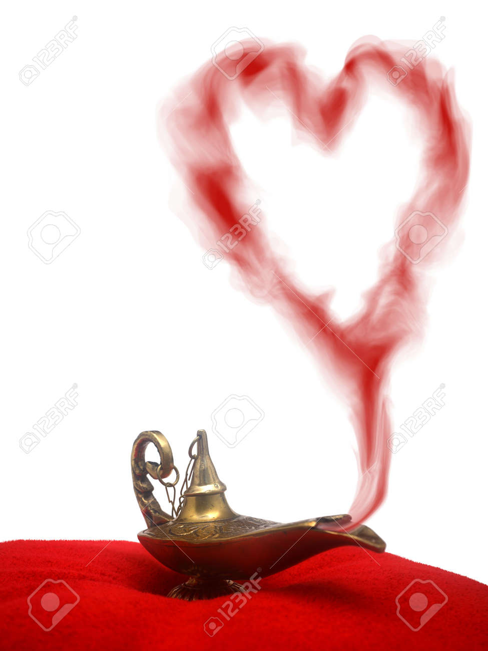 Genie lamp stock photos pictures royalty free genie - A Magical Genie Lamp With Smoke On A Red Velvet Pillow With A Heart Shaped Smoke