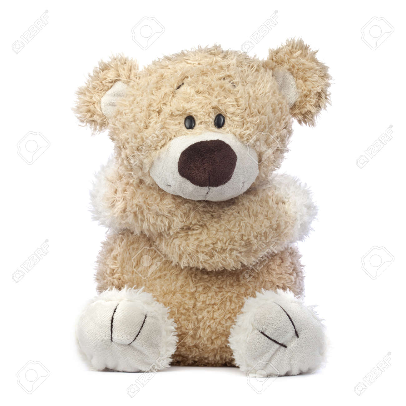 An adorable teddy bear that is cold sad and hurt hugging himself an adorable teddy bear that is cold sad and hurt hugging himself stock altavistaventures Choice Image