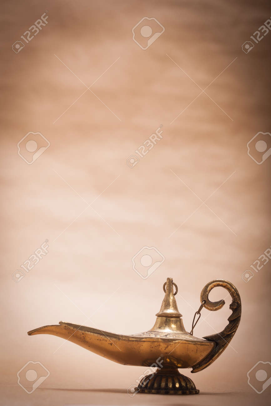 Genie lamp stock photos pictures royalty free genie - Lamp Genie A Magic Genie Lamp Isolated On A Sand Color Background In