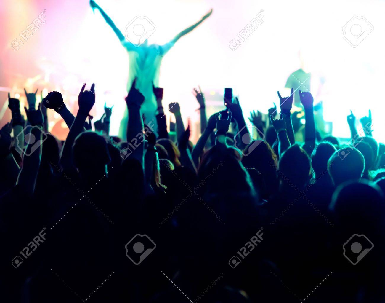silhouettes of concert crowd in front of bright stage lights Stock Photo - 9954497
