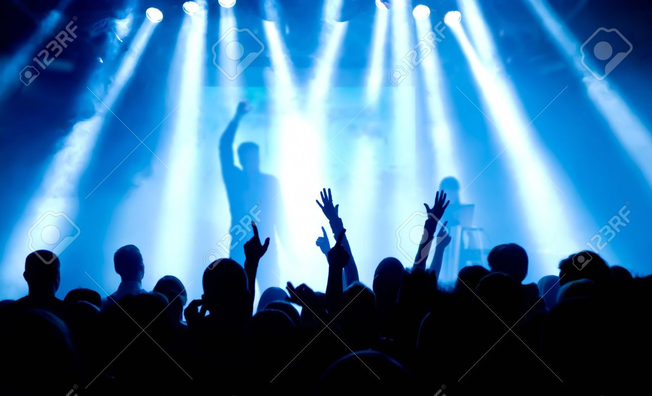 silhouettes of concert crowd in front of bright stage lights Stock Photo - 9954512