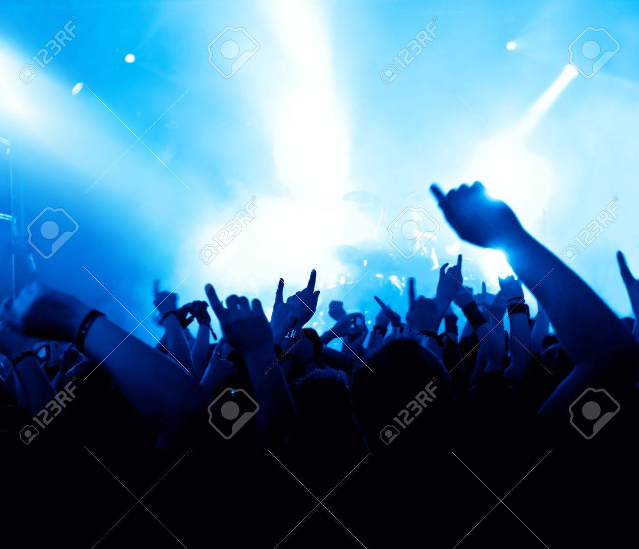silhouettes of concert crowd in front of bright stage lights Stock Photo - 9954494