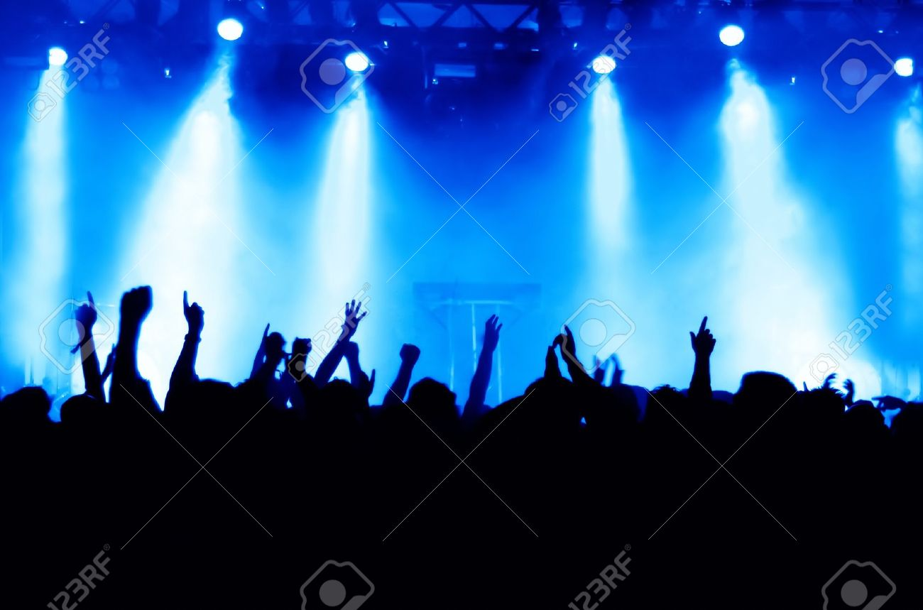 silhouettes of concert crowd in front of bright stage lights Stock Photo - 9954517