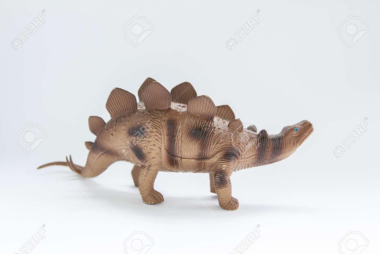 toy dinosaur on white background - 147275288