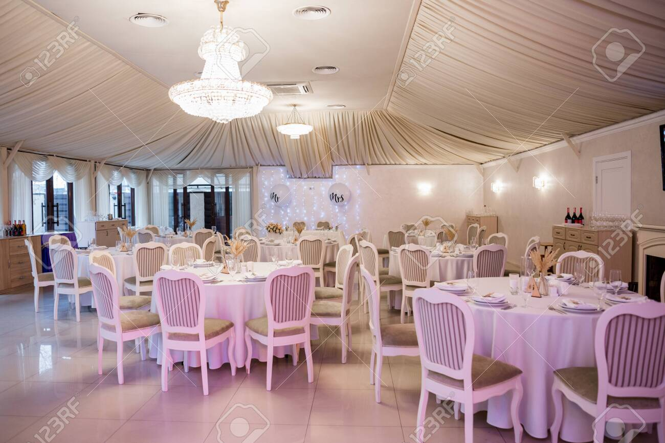 decor of flowers at a wedding in banquet hall - 148429942