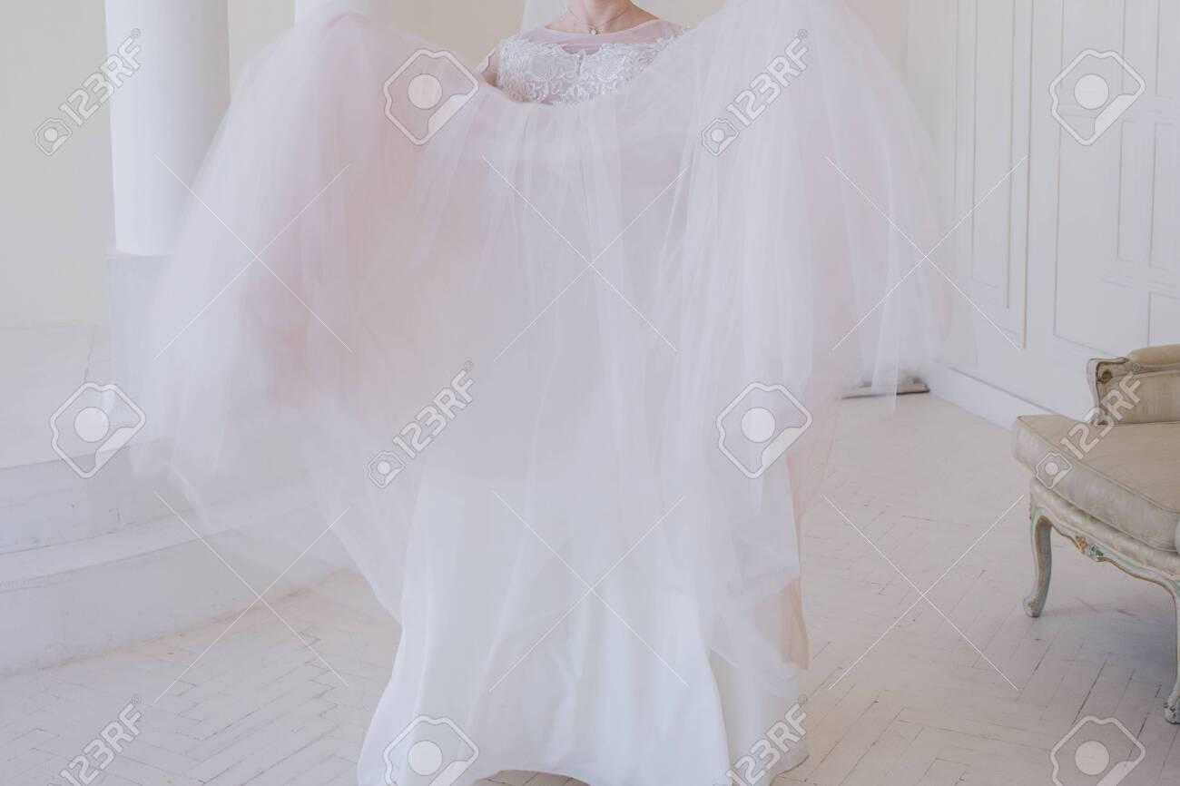 bride in a wedding dress in bright room - 152693244