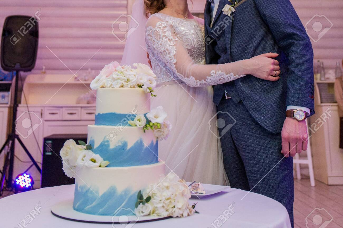 The Groom And The Bride Cut Wedding Cake Stock Photo Picture And Royalty Free Image Image 152080609