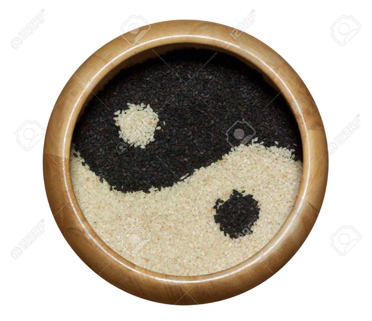 yin yang black and white sesame in wooden bowl isolated on white