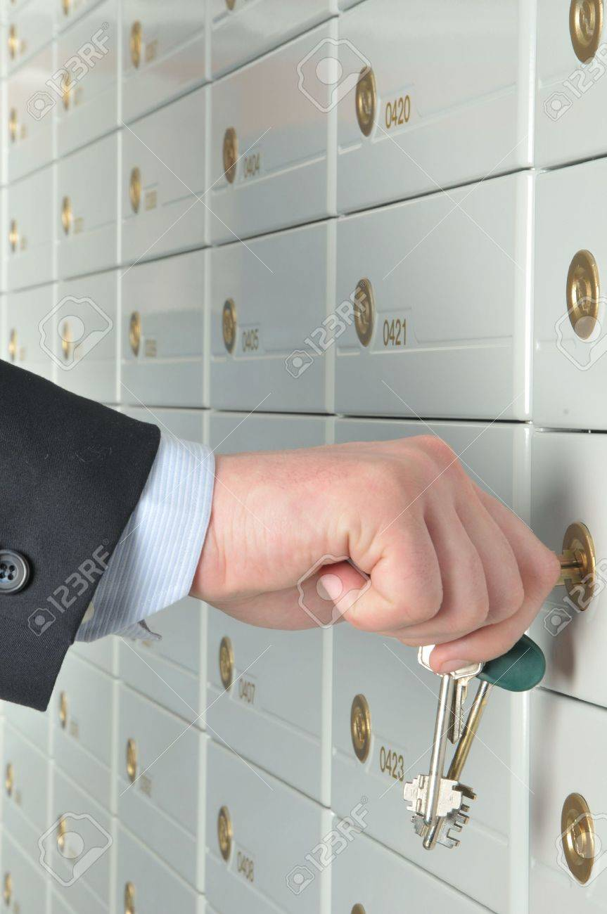 copula of the keys is in the hands of business man which opens the deposit safe in a bank Stock Photo - 5165695