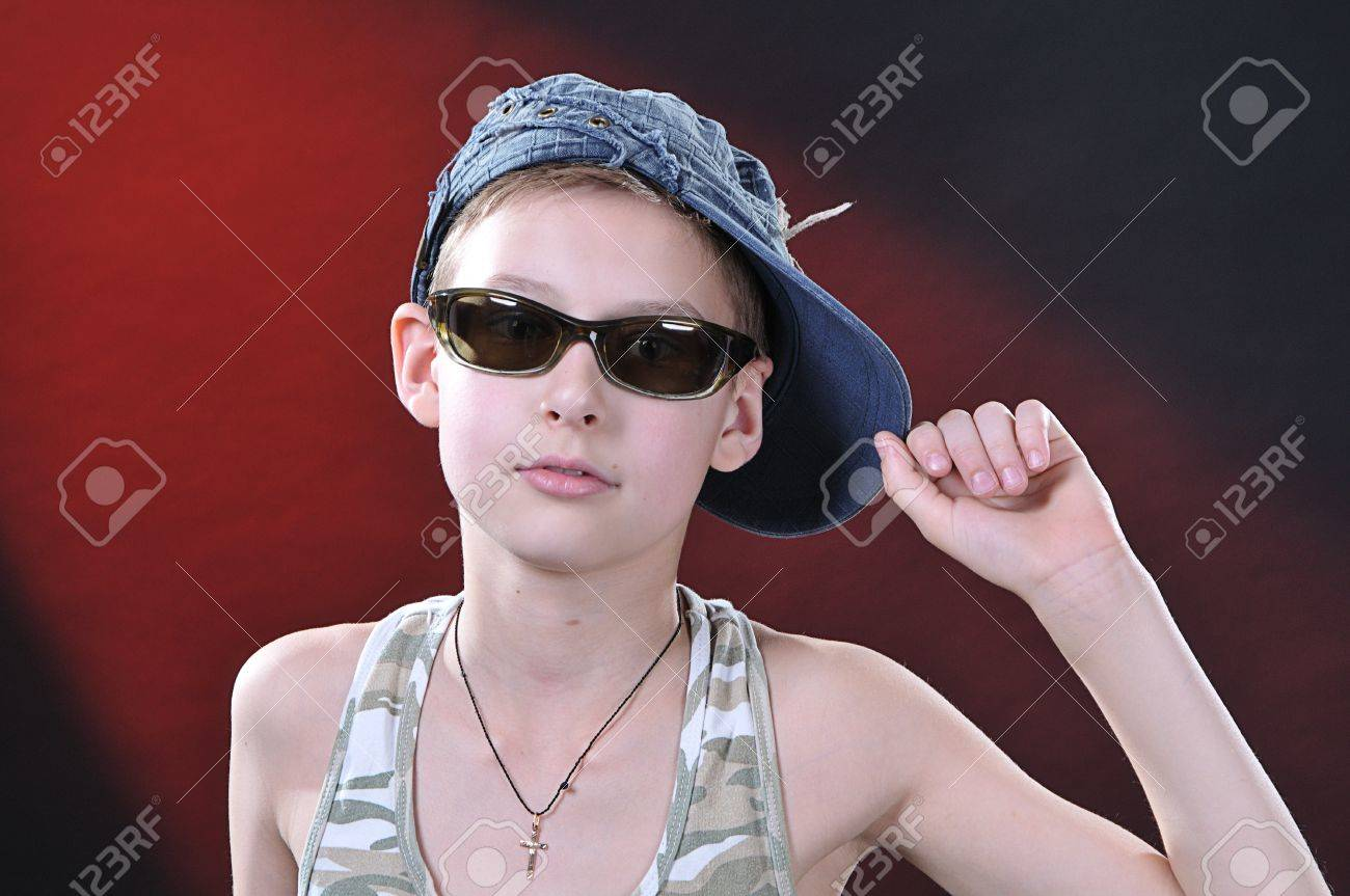 83c468e87bf9 Portrait Of Is 10-11 Years Old Boy In A Jean Cap And Sun Glasses ...
