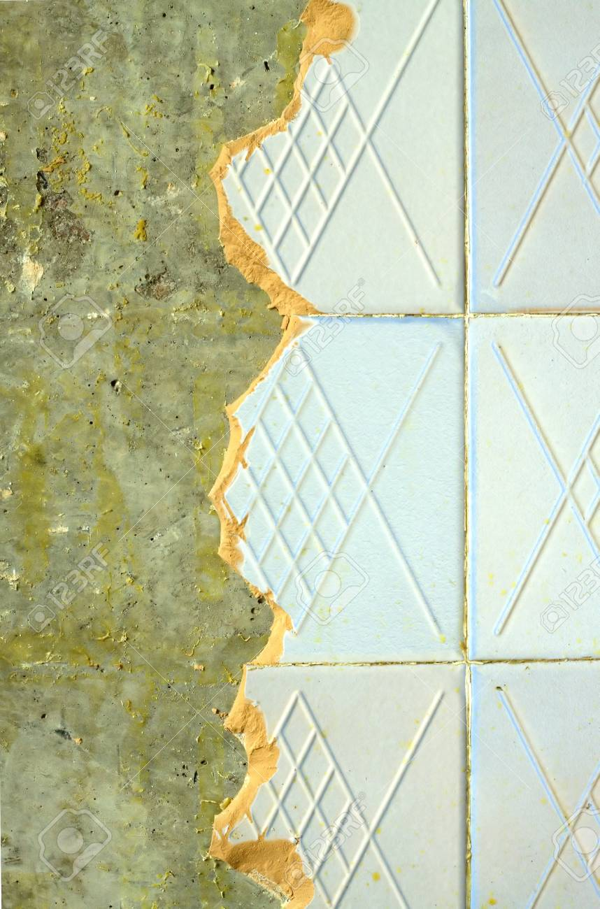 Concrete wall in house with broken ceramic tiles in the process concrete wall in house with broken ceramic tiles in the process of repair close up stock dailygadgetfo Gallery