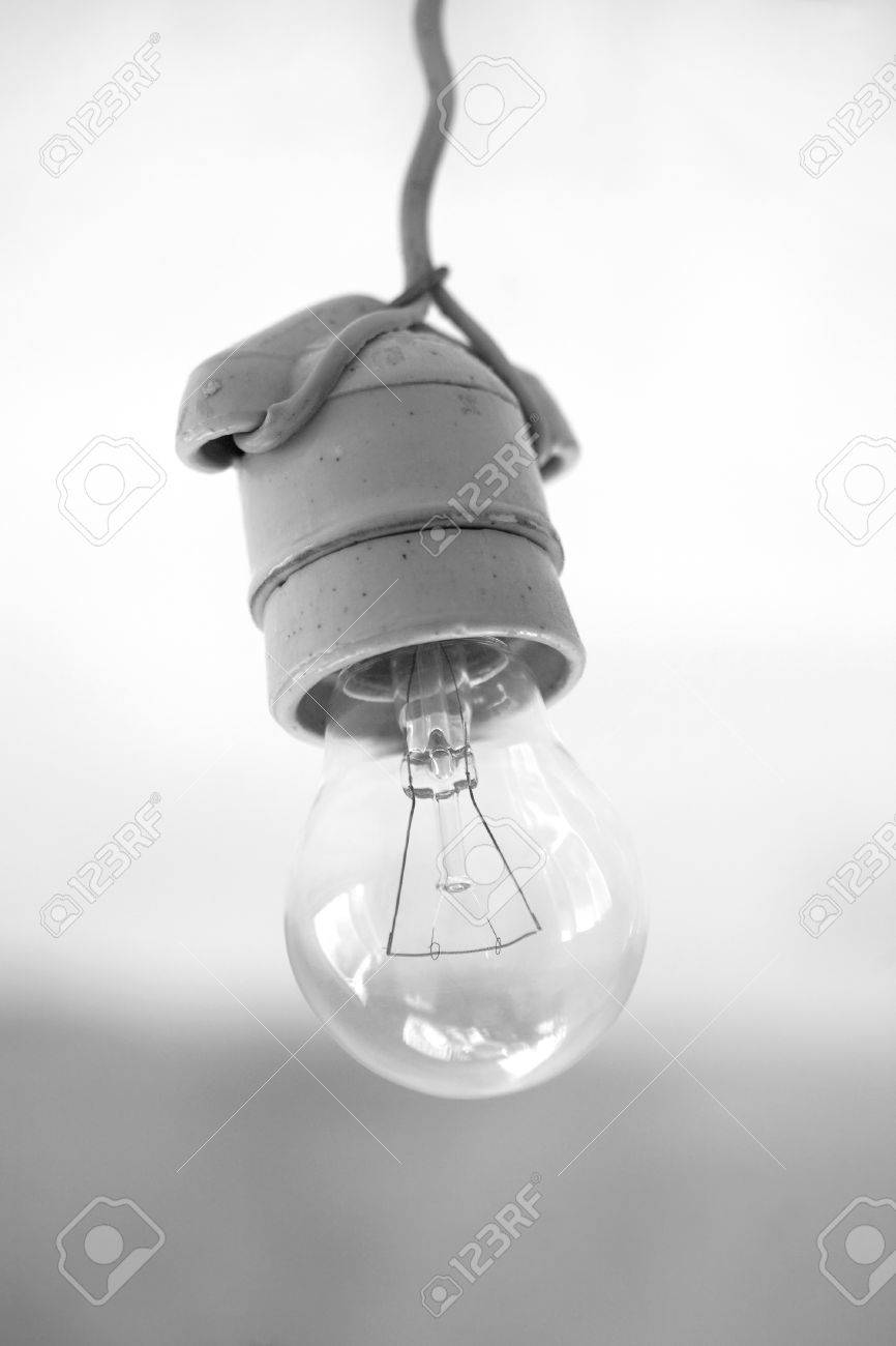Turning Off An Electric Light Bulb In Ceramic Holder Hanging.. Stock ...