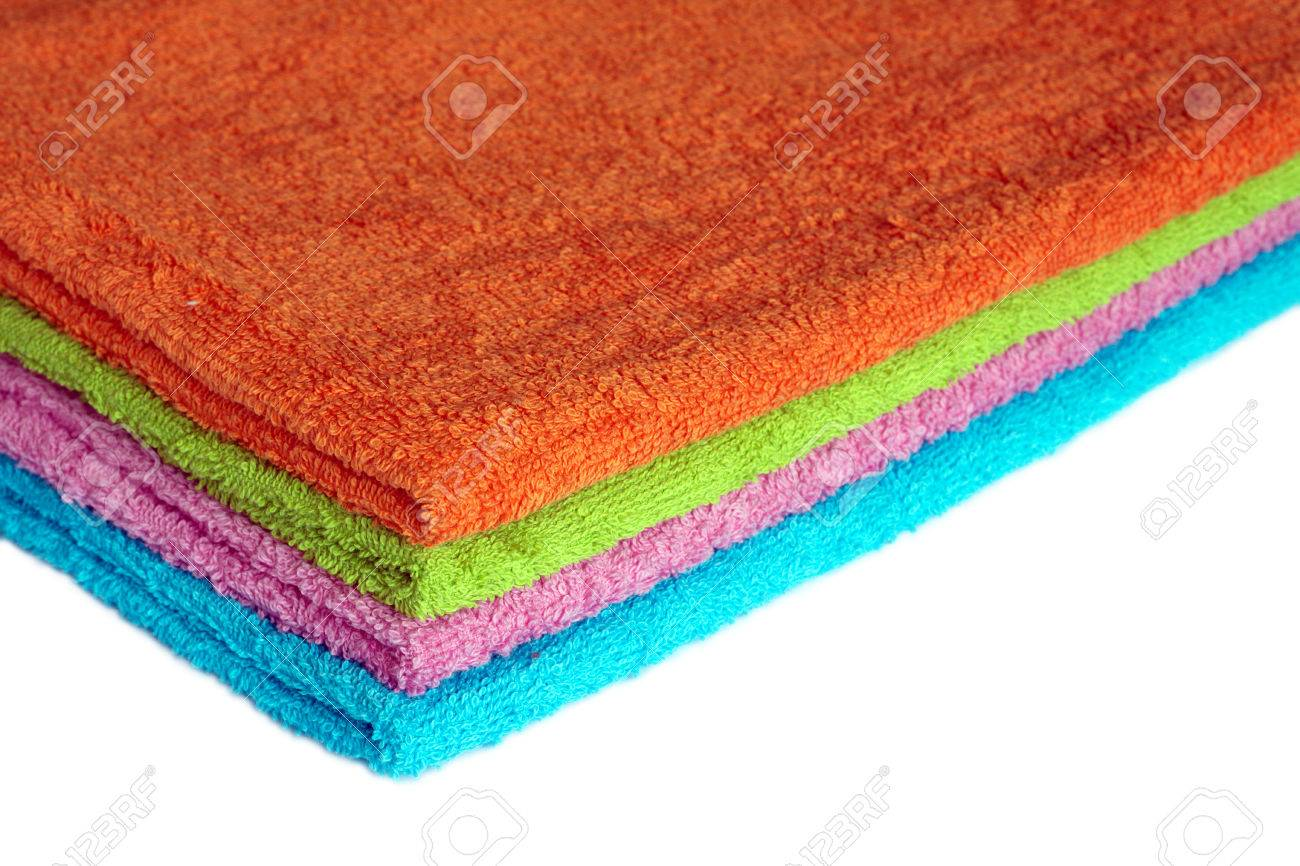 Four Clean Soft Double Bath Towels Set Of Different Colors Stacked Isolated  On White Background.