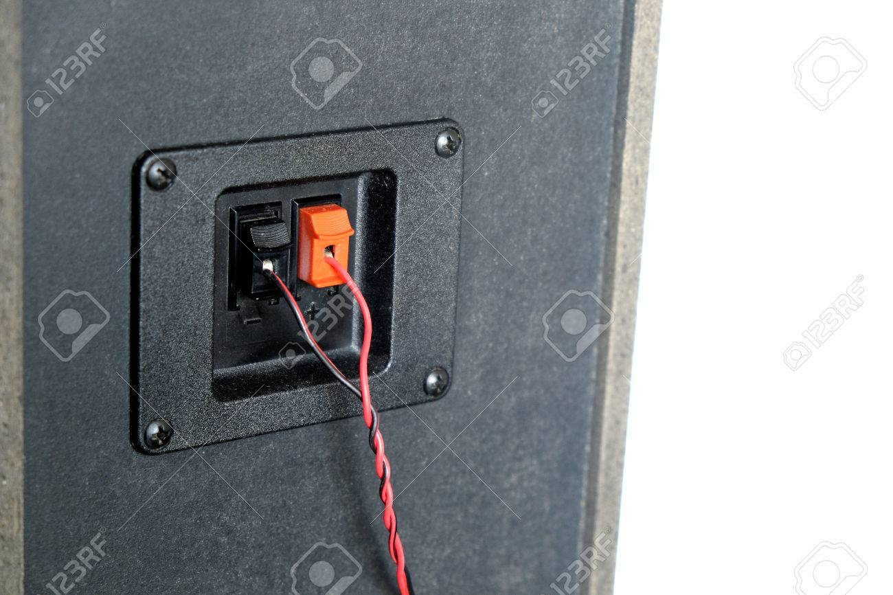 Red And Black Twisted Wire Connected To Cable Connection Socket Electrical Wiring Connections On Rear Side Speaker System Box