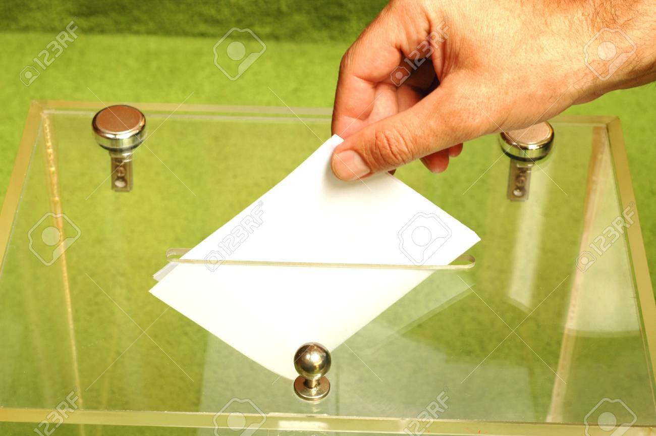 Hand putting a blank ballot inside the box, elections concept Stock Photo - 11304447
