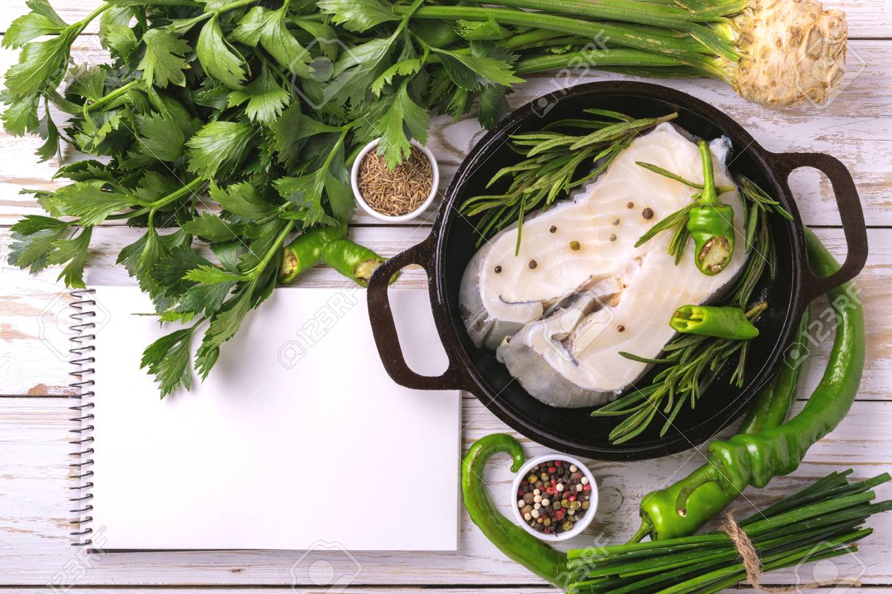 Raw fresh white fish steak with green vegetables ingredients stock raw fresh white fish steak with green vegetables ingredients in frying pan around recipe notebook for forumfinder Image collections