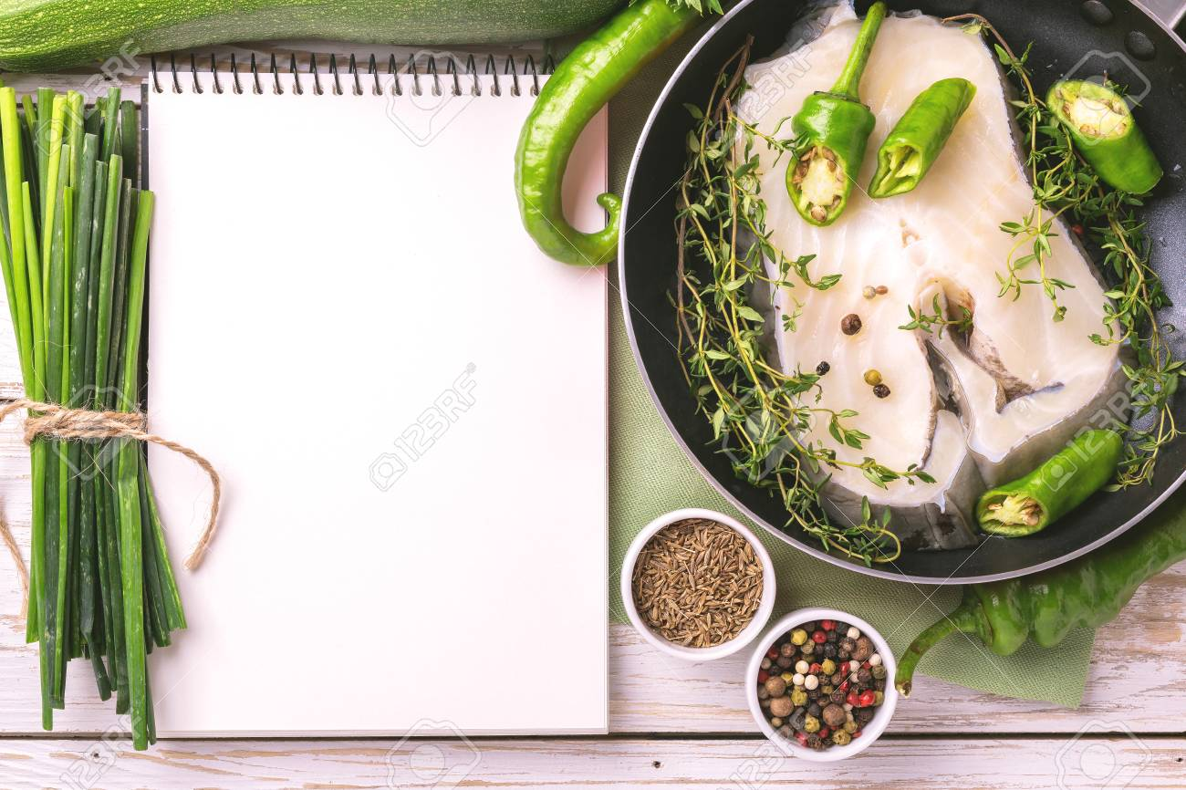 Raw fresh white fish steak with green vegetables ingredients stock raw fresh white fish steak with green vegetables ingredients around recipe notebook for tasty diet forumfinder Image collections