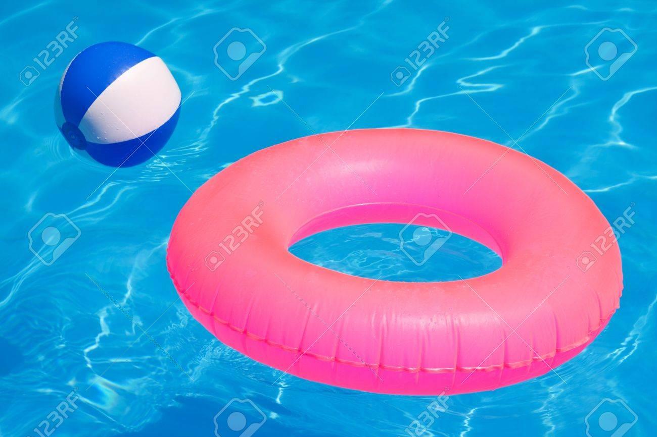 20990460-Pink-pool-float-pool-ring-in-cool-blue-refreshing-blue-pool-Stock-Photo.jpg