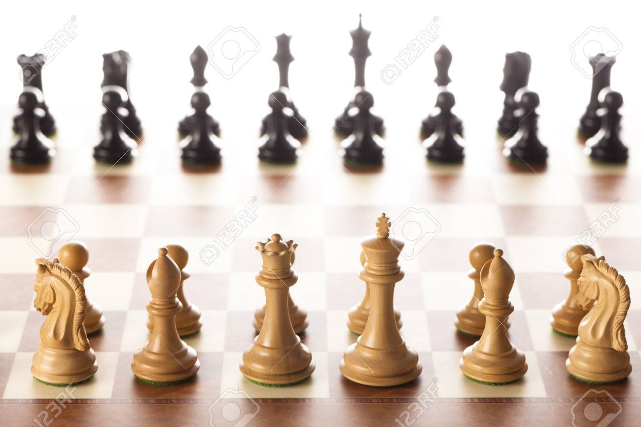 Chess setup - black and white chess pieces on a chessboard standing