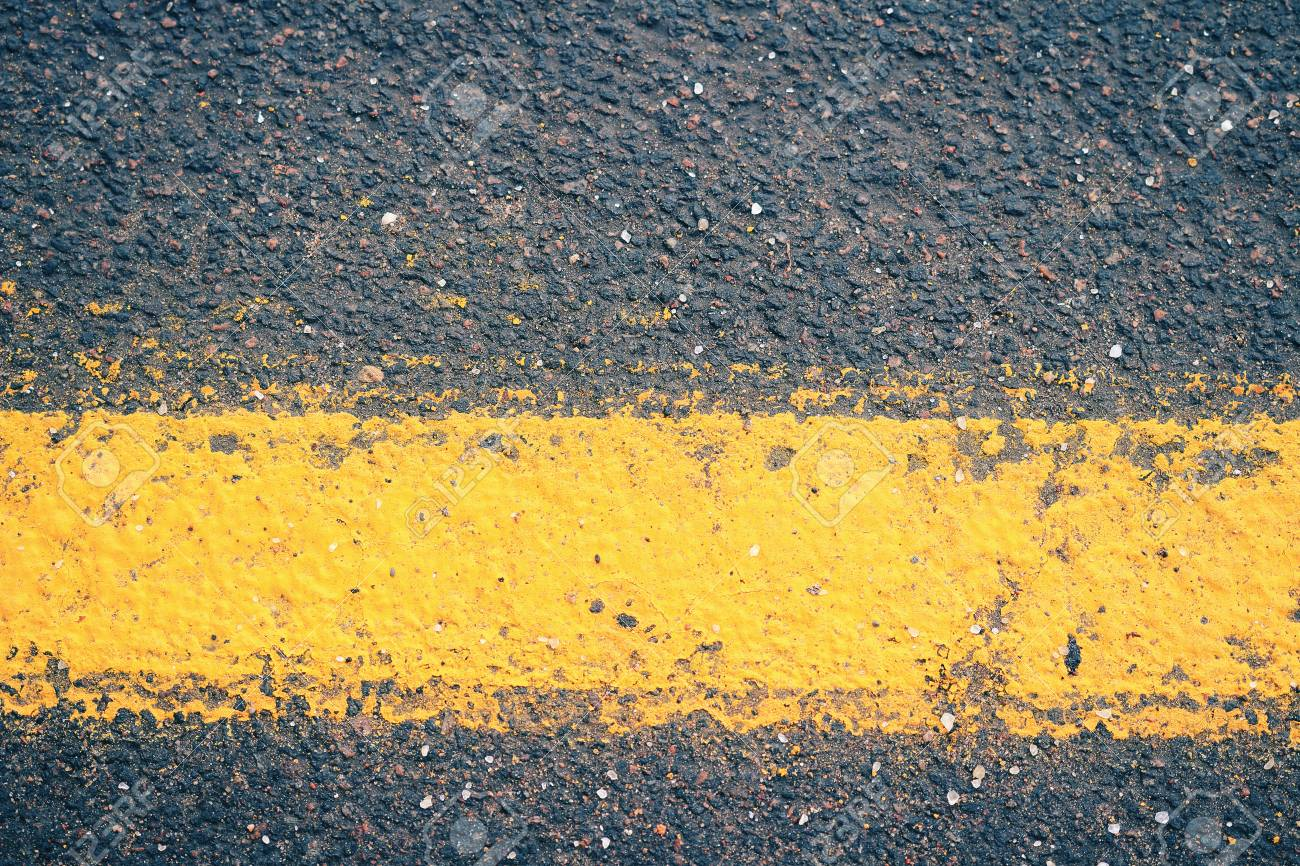 Asphalt closeup  Background tracks closeup  Road with yellow