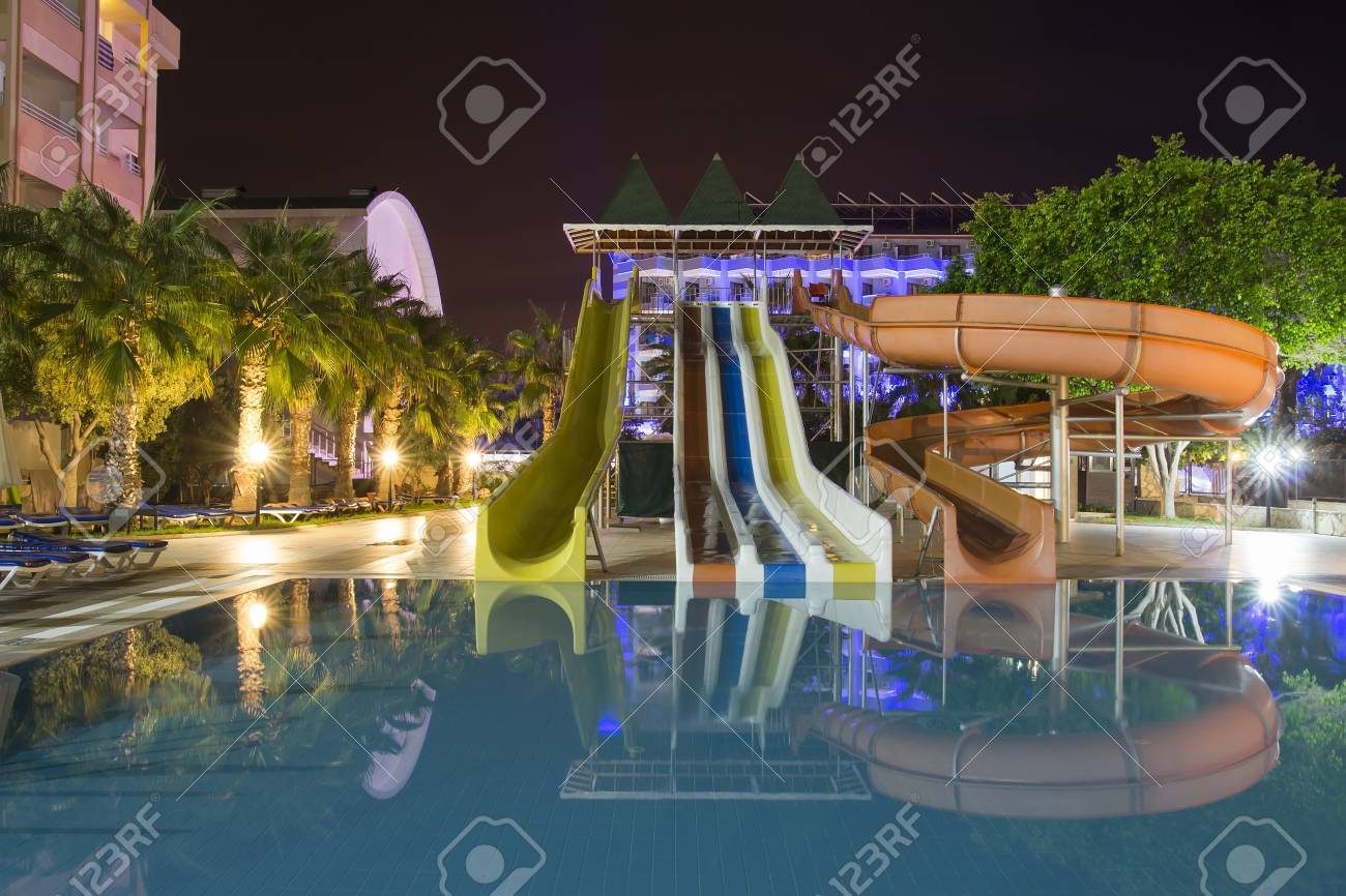 territory of resort hotel with swimming pool, water slides and..
