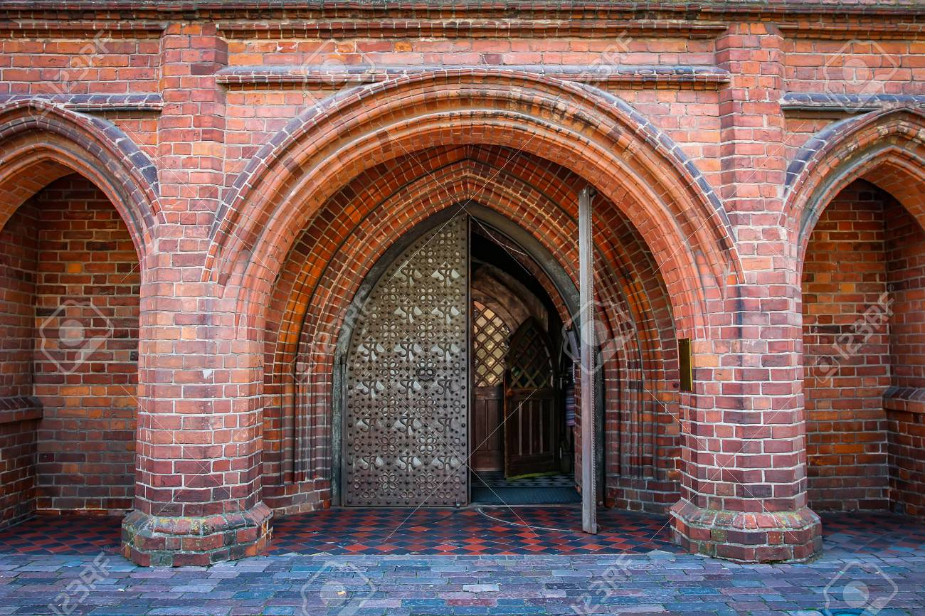 Entrance Arch To Catholic Church Of Gothic Style Red Brick Arches In The