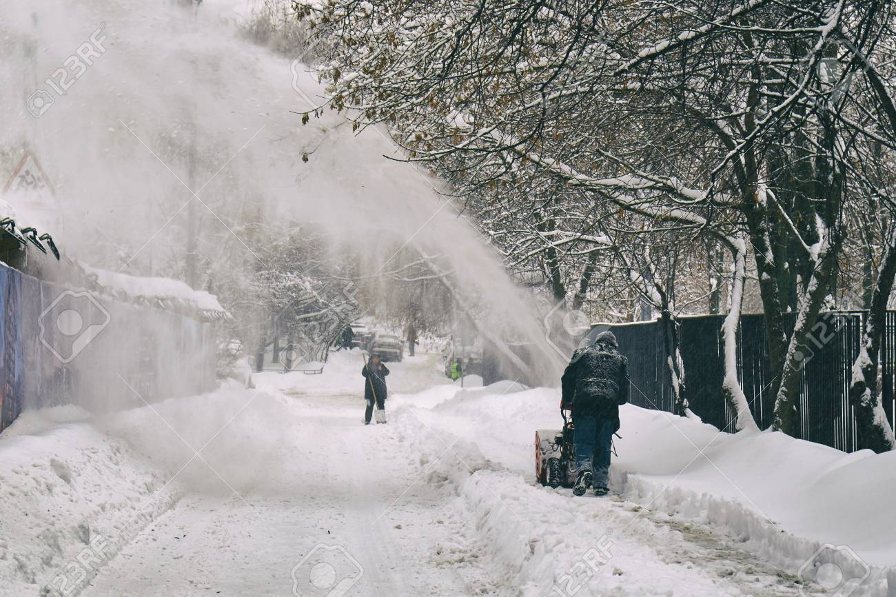 Man Removing Snow From The Moscow Street Using Snow Blower After.. Stock  Photo, Picture And Royalty Free Image. Image 95320835.