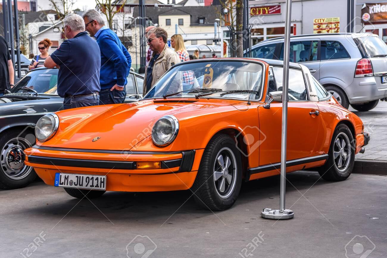 GERMANY, LIMBURG , APR 2017 orange PORSCHE 911 TARGA 1983 in..