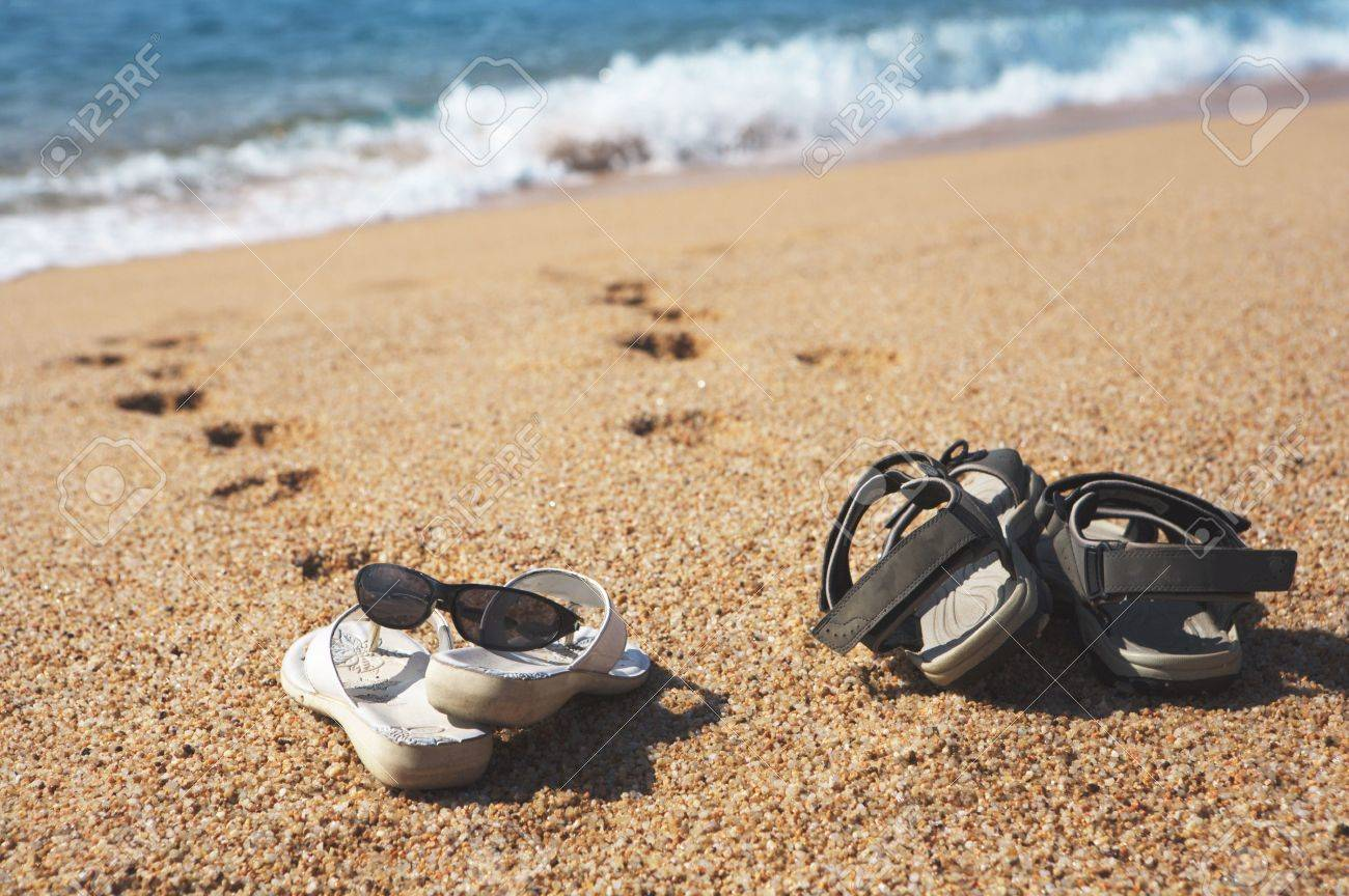 60aba8190 a photo of two pairs of beach shoes at the seaside Stock Photo - 3361896