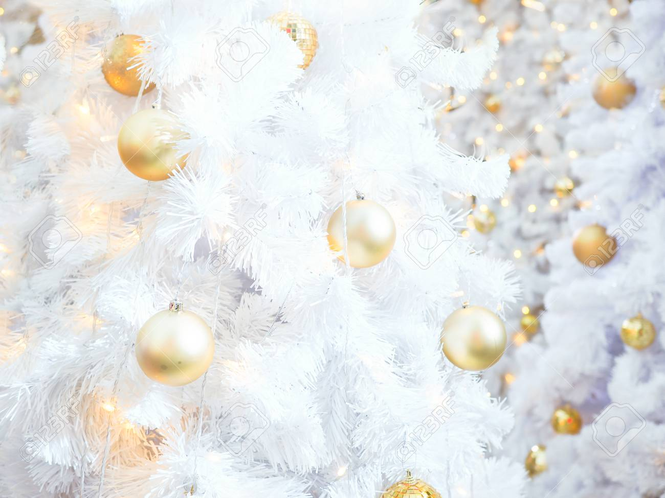 Golden Ball On White Christmas Tree Background For Xmas Wallpaper