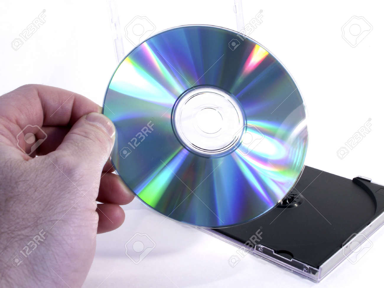 Hand holds CD with case in background. Stock Photo - 258701