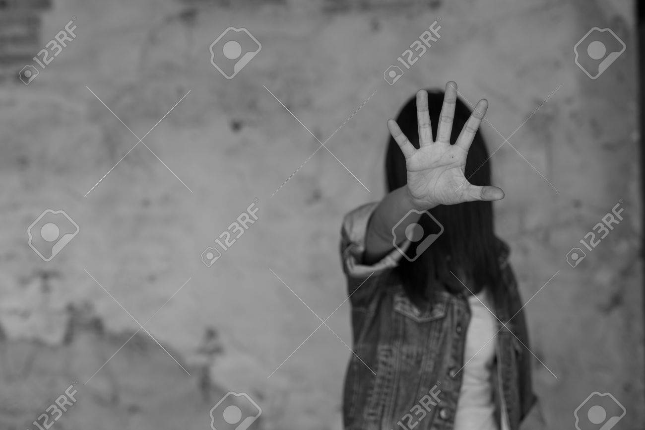 Woman in angle of abandoned building , stop violence against Women, international women's day - 74675448